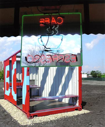 Neon sign with view of storage-container art installation