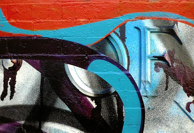 Orange and turquoise graffiti curves surround 'OF'
