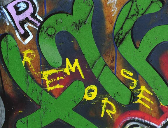 Yellow hand-paited letters spell out REMORSE, large green cut-out letters behind