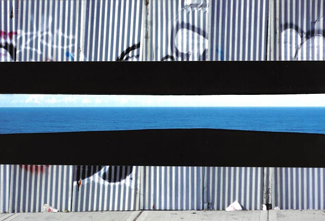 Graffiti fence with insert of ocean view, light blue water