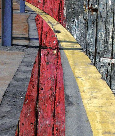 Red, black, grey vertical lines, and blues columns, transected by arching yellow line